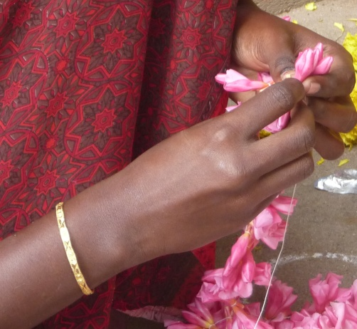Practiced Hands String Flower Petals, Tiruvannamalai, South India