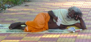Sadhu Hanging Out on Sidewalk