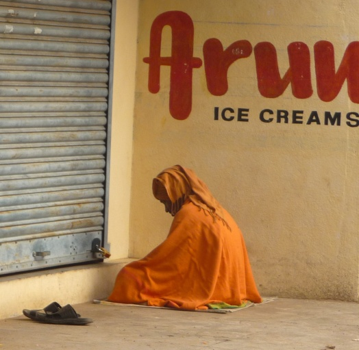 Sadhu Meditating by Closed Store Front, Tiruvannamalai, South India